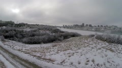 Trees covered in snow and frost along the Saskatchewan river bank Stock Footage