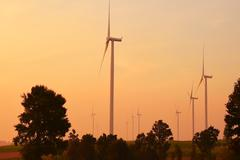 Wind turbines silhouette at sunset Stock Photos