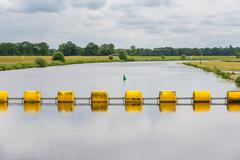 floating barrage in dutch river vecht - stock photo