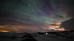 Aurora northern lights over snow covered bridge, Thingvellir, Iceland Stock Footage