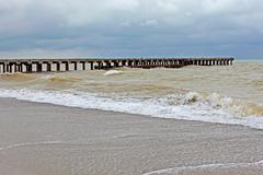 Old pier in stormy weather Stock Photos