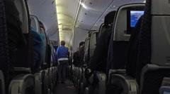 Travel international flight passenger cabin 4K 003 Stock Footage