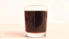 Pour cola into a glass backwards slowmo Stock Footage