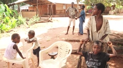 Africa village kids sitting and stairing Guinea Bisseau4 Stock Footage