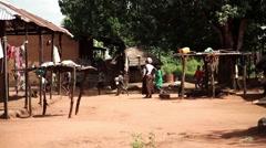 Africa village kids running Guinea Bisseau - stock footage
