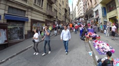 Hundreds of People walk along the Ladeira Porto Geral area in 25 March Stock Footage