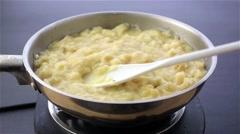 Potato leek soup being stirred in pan - stock footage