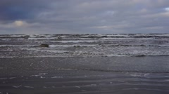 Sea in December storms and waves beat against the shore - stock footage