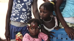 Africa village two girls with braiding Guinea Bisseau Stock Footage