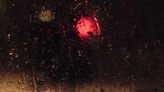 Night Time Traffic Lights Through A Rainy Window Stock Footage