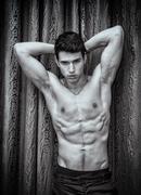 Handsome shirtless muscular young man, looking at camera Stock Photos