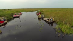 Stock Video Footage of Birds eye view of resting air boats in the Florida Everglades