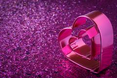 pink heart with glitter background for valentines day - stock photo