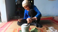 Woman making betel with betel and areca, Asia Stock Footage