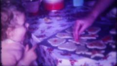 1517 - mother & daughters bake cookies at home - vintage film home movie Stock Footage
