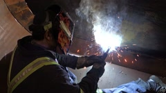Tradesman welding inside steel construction. Stock Footage