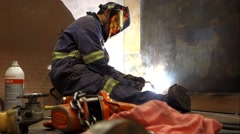 Tradesman welding inside steel construction, two scenes. Stock Footage