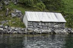 Cottage on the geirangerfjord Stock Photos