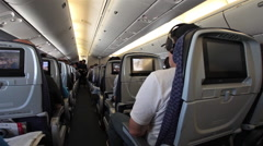 Passenger cabin commercial flight across country HD 3911 Stock Footage