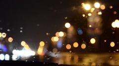 Defocused lights. Driving on a rainy highway, cars braking. Rain on windshield. Stock Footage