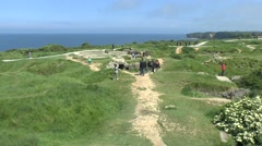 General view over the bomb craters on Pointe du Hoc, Normandy, France. Stock Footage