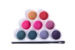 top view of mineral eye shadows and brush - stock photo