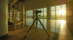 The camera stands by sky scraper business center windows by sunset background Stock Footage