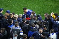 danilo silva of dynamo kyiv gives autographs - stock photo