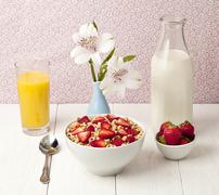 bowl of cereals with strawberry juice and milk - stock photo