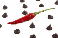 Chilly pepper with chocolate kisses Stock Photos