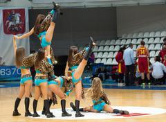 cheerleaders on basketball arena - stock photo