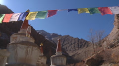 Stupas and prayer flags at background of Himalayan Mountains in Ladakh, India Stock Footage