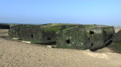 Remains of the mulberry harbour, Arromanches beach, Normandy, France. Stock Footage