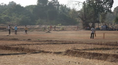 INDIA, GOA - 2012: Boys are playing cricket on a field of village Stock Footage