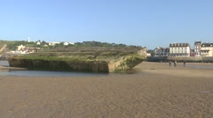 Spud pier, part of the mulberry harbour, Arromanches beach, Normandy, France. Stock Footage