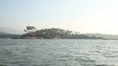 Views of islands from the sea near a beach palolem at sunset India Goa - stock footage