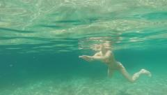 Woman swimming underwater in mediterranean sea Stock Footage