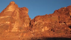 Red cliffs of Wadi Rum desert Stock Footage