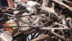 Mechanics repairs chassis Stock Footage