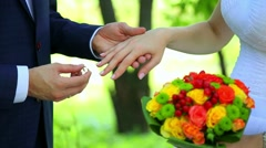 Groom is putting wedding ring. wedding rings. hands of couple in love. ceremony Stock Footage