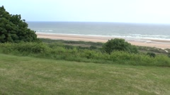 Stock Video Footage of View along the sand dunes above Omaha Beach, Normandy, France.