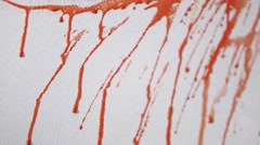 Splashes and streaks of paint on canvas background - stock footage