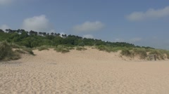 View looking up the sand dunes above Omaha Beach, Normandy, France. - stock footage