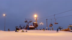 Ski lift station at night on top of the hill Stock Footage