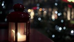 Candle burning in the street in December before the New Year Stock Footage