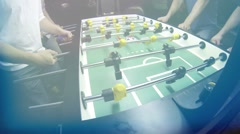 Guys playing Foosball Table soccer at a sports bar Stock Footage