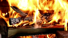 Closeup of fireplace full of wood and fire Stock Footage