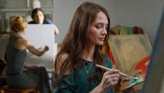 Young artists painting - stock footage