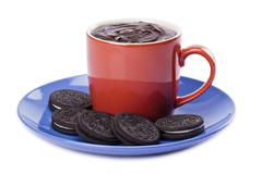 Cup of melted chocolate with chocolate cookies Stock Photos
