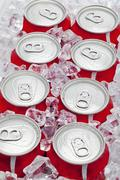 Eight pop cans Stock Photos